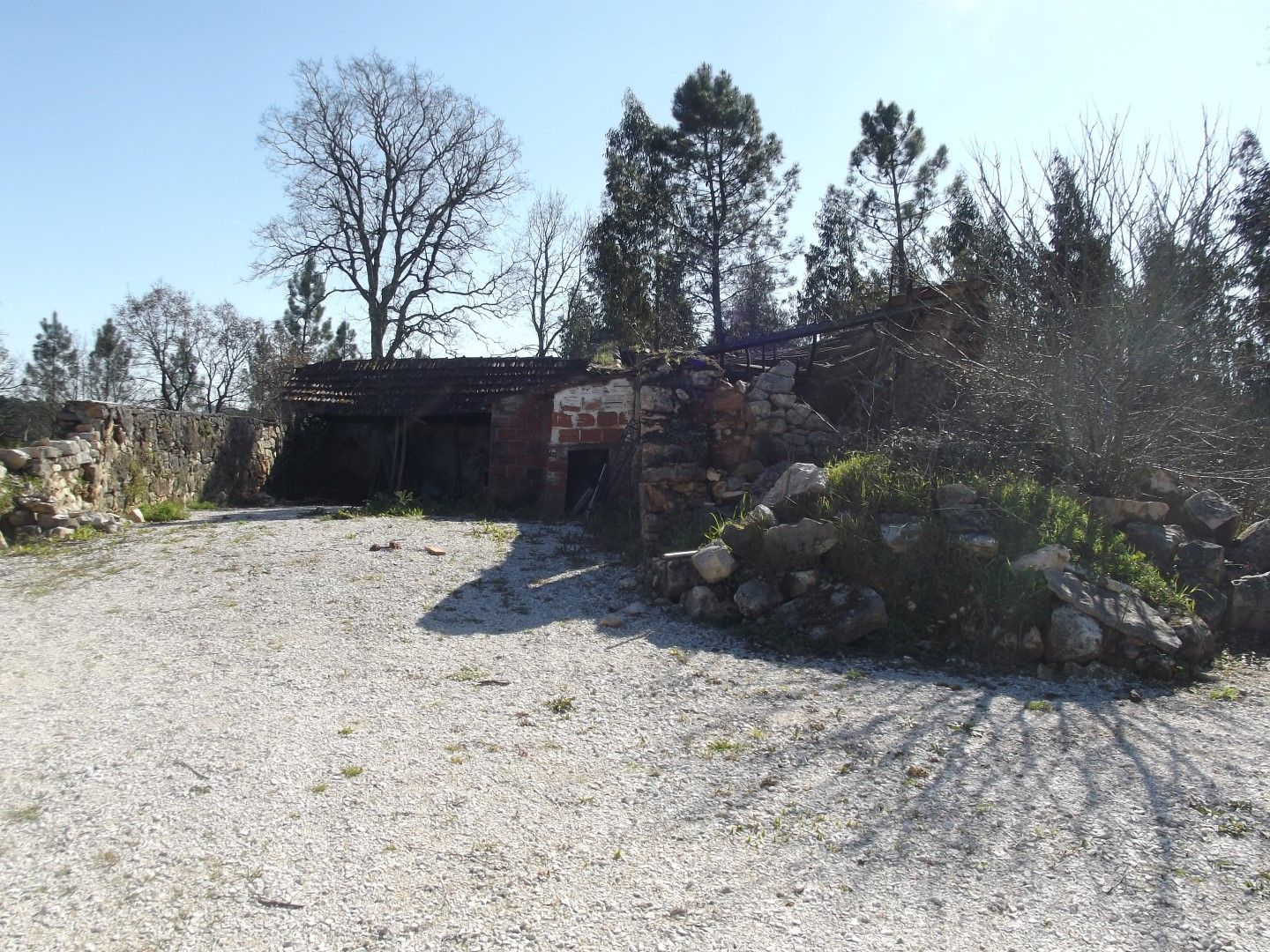 Small farm with stone house land garage and ruin